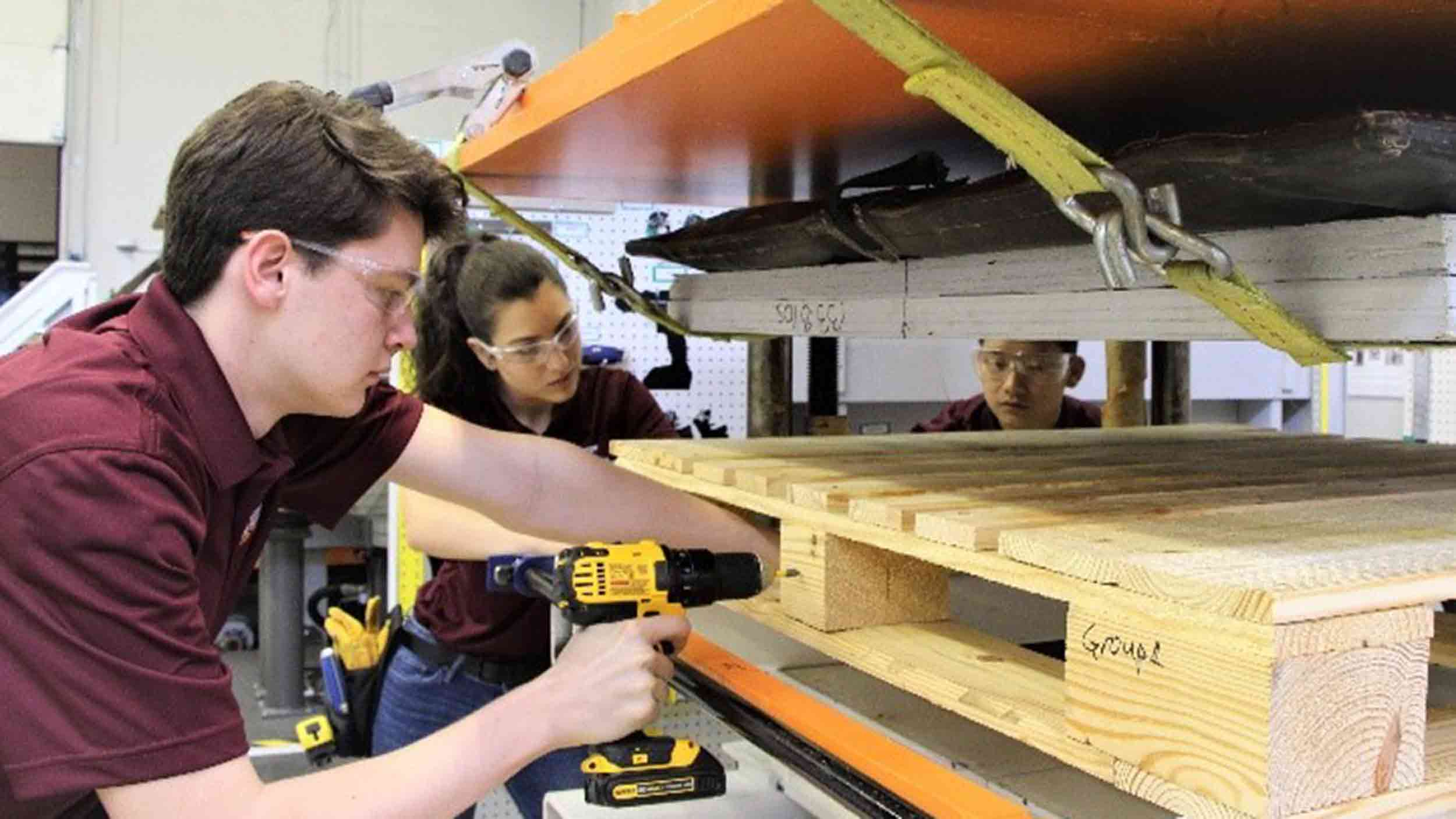 Students preparing a pallet for testing