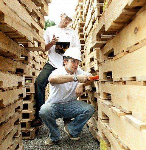 Zack and Jason working with pallets